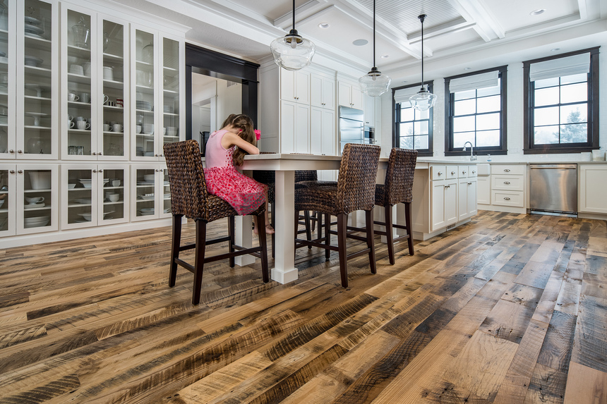 Girl sitting at table on reclaimed floor