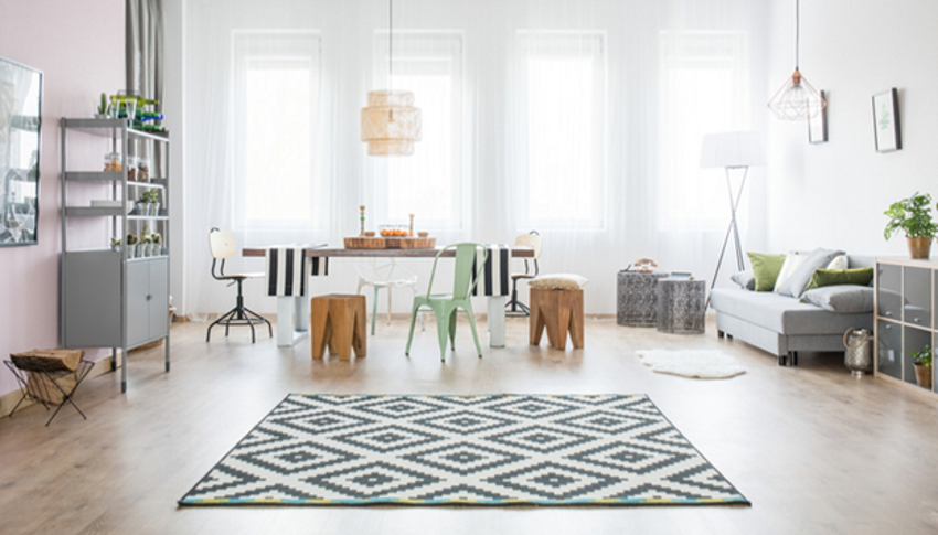Area rugs can  strikingly accent the color of your hardwood floors.