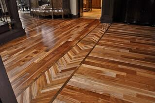 Hardwood floor borders can be created by placing boards at diagnoal angles to the rest of the hardwood flooring.