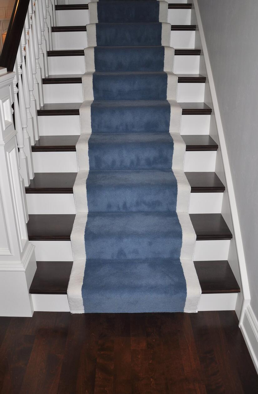 Carpet runners help create a flow between hardwood floors and hardwood staircases.