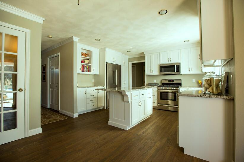 Paint is often used on kitchen cabinets to provide a contrast with the hardwood floor colors.