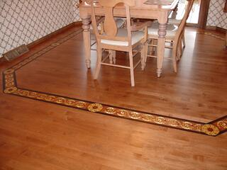 Hardwood floor borders can be used to frame an area within a room.