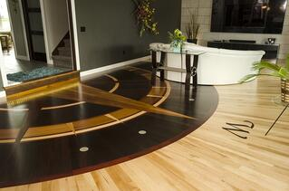 Compass themes are a popular choice for hardwood floor medallions.