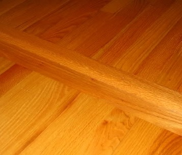 A hardwood floor crosspiece is ideal for separating areas in an open floorplan.